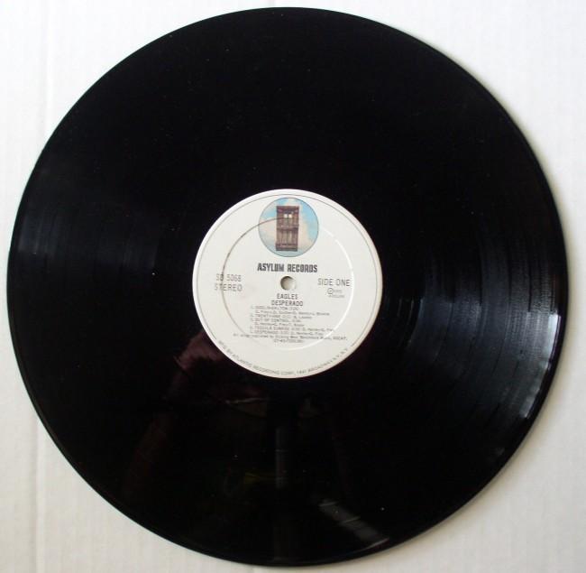 Eagles / Desperado Asylum SD 5068 3 white label door in a circle